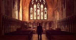 13063-man-standing-church-aisle-silhouette-pastor-620x330